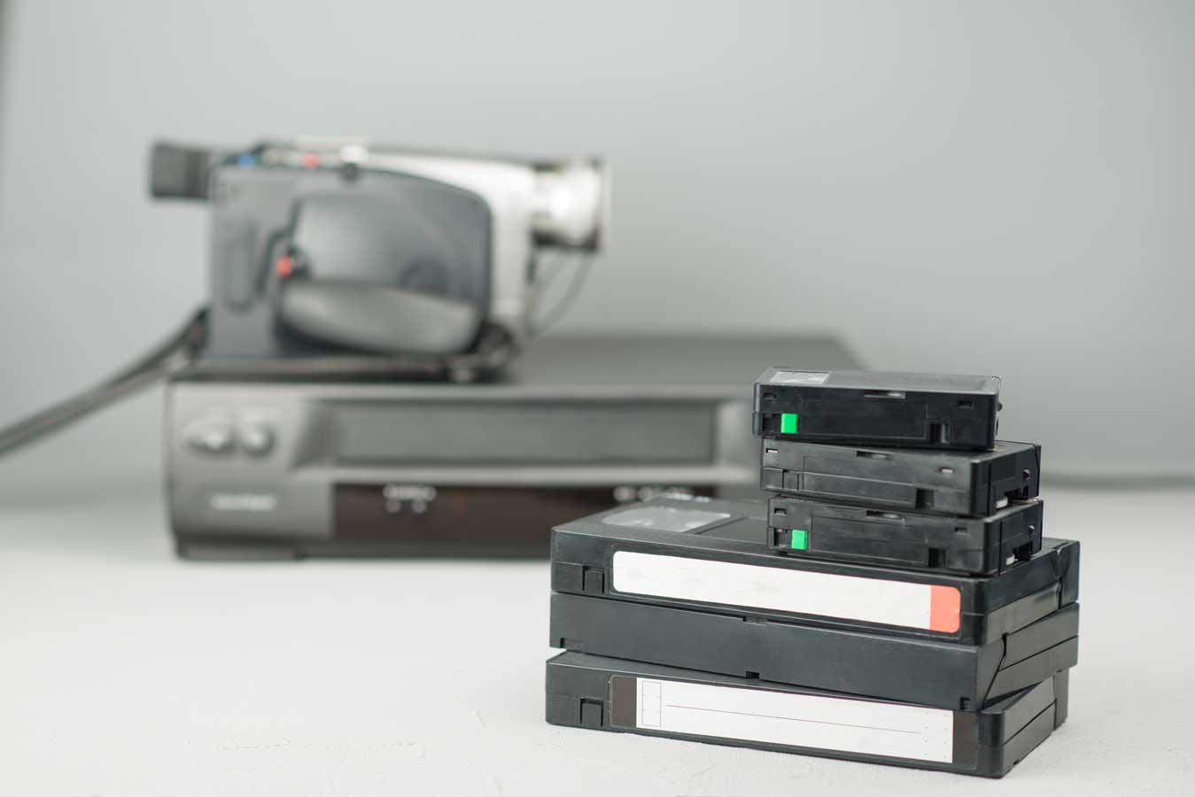 VHS-videotapes,-video-player-and-video-camera